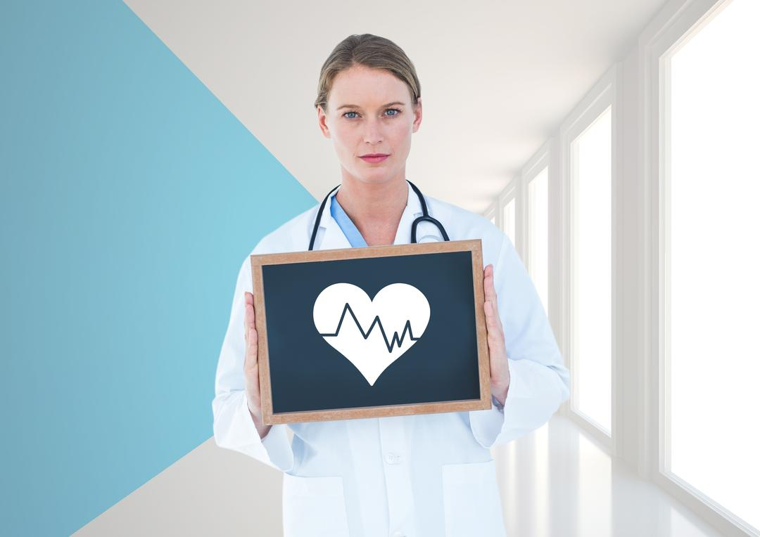 Portrait of doctor holding a slate board in hallway Free Stock Images from PikWizard
