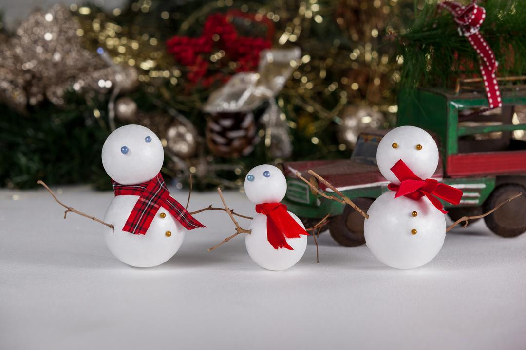 Three Christmas snowman ornaments against Christmas decoration Free Stock Images from PikWizard