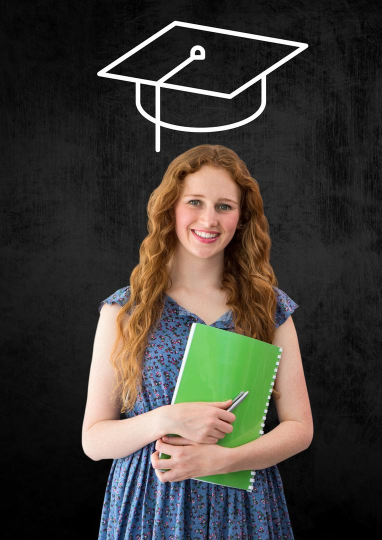 Digital composition of woman standing and holding book with graduation cap in background