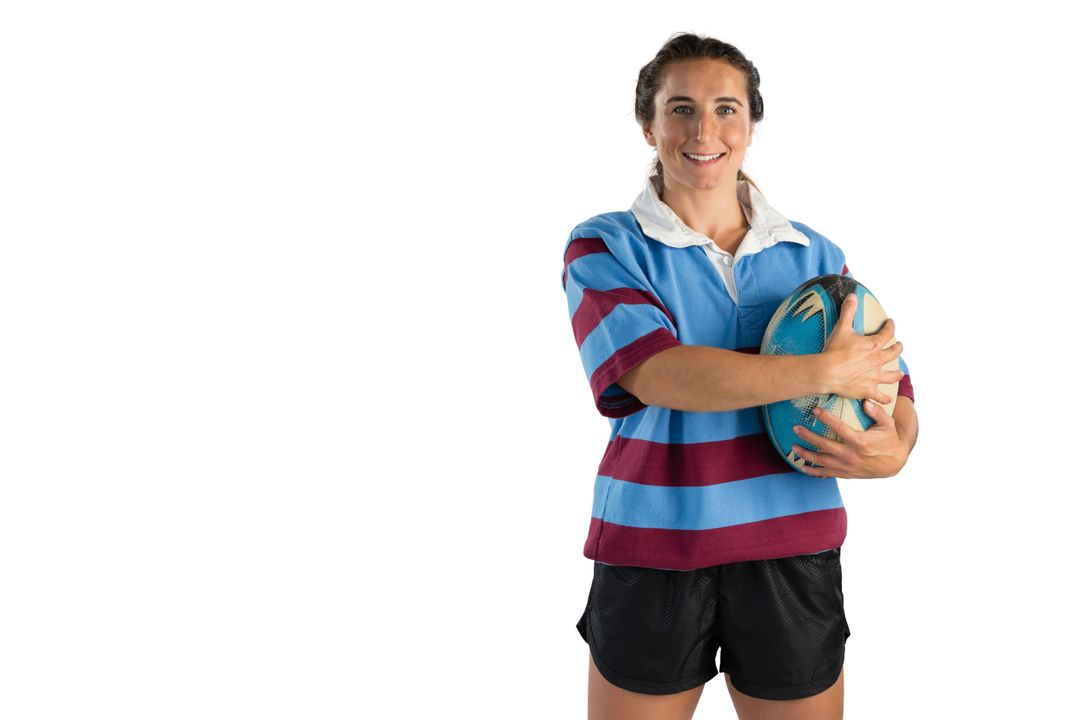 Portrait of happy female player holding rugby ball against white background Free Stock Images from PikWizard