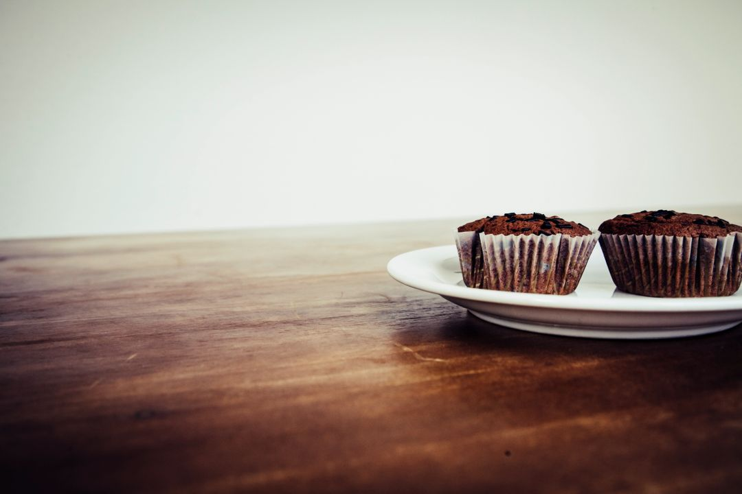 Brown Cupcake on White Ceramic Plate