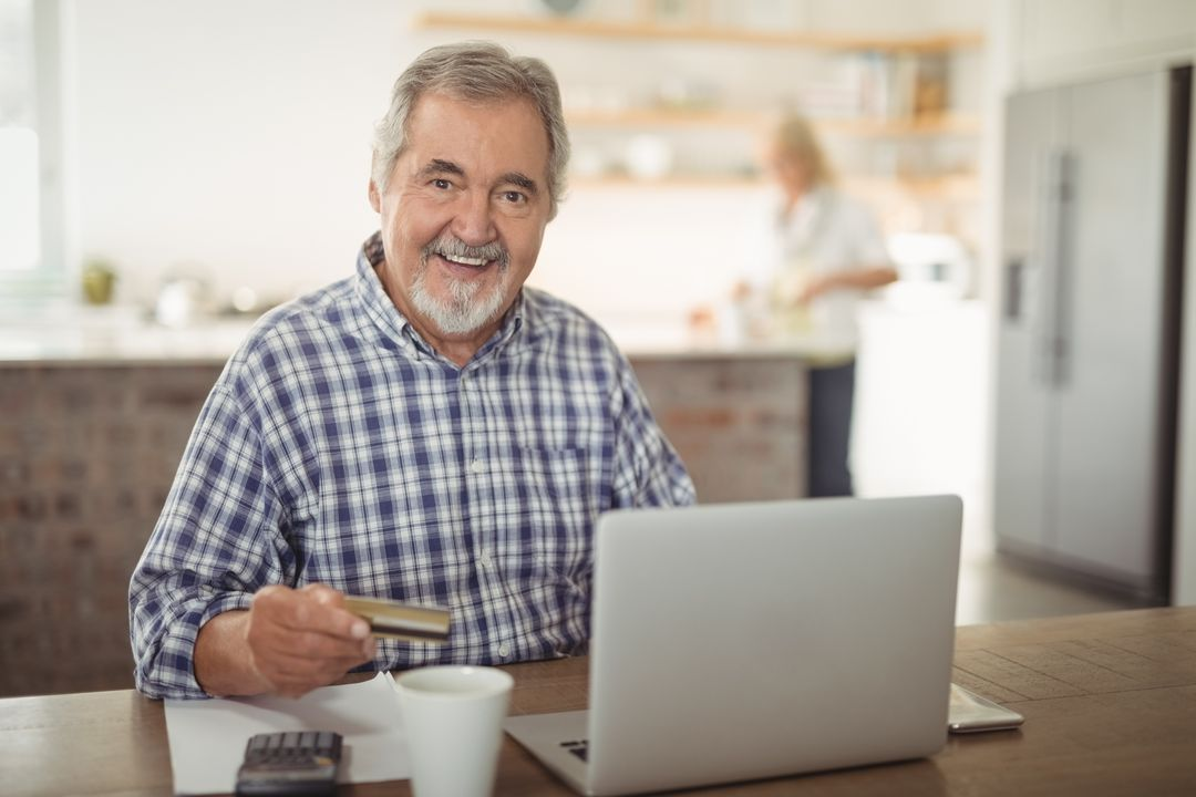 Image of an Elderly Man Being on his Laptop and Smiling into the Camera