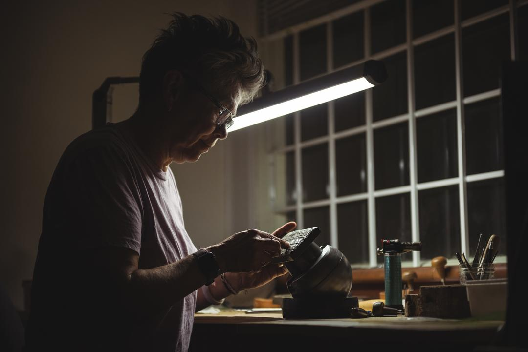 Attentive craftswoman working in workshop Free Stock Images from PikWizard