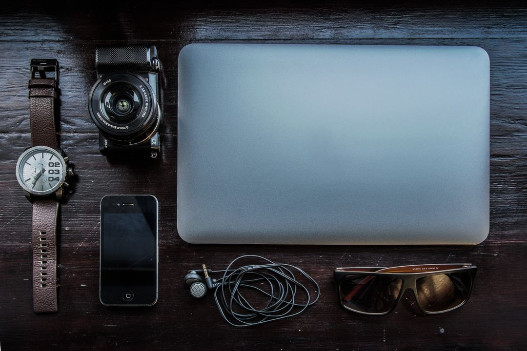 Image of a Computer, Camera, Smartphone, Watch on a Desk