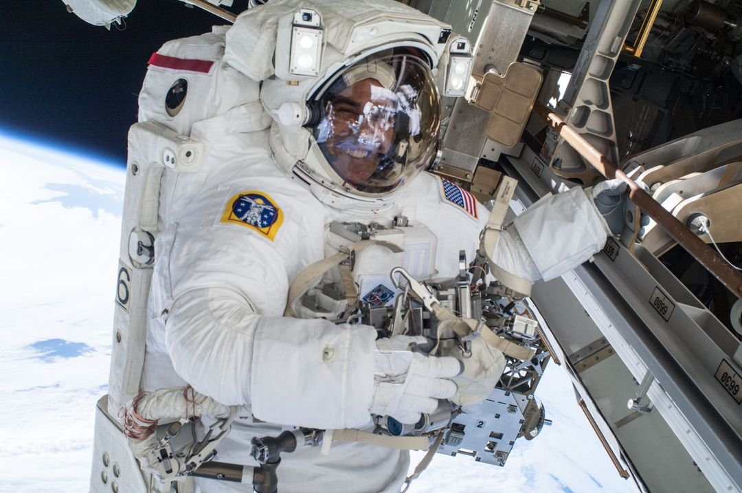 View of Rick Mastracchio,in his Extravehicular Mobility Unit (EMU),working to mate spare Pump Module (PM) Quick Disconnects (QDs) during International Space Station (ISS) Extravehicular Activity (EVA) 25.  Image was released by astronaut on Twitter. Free Stock Images from PikWizard