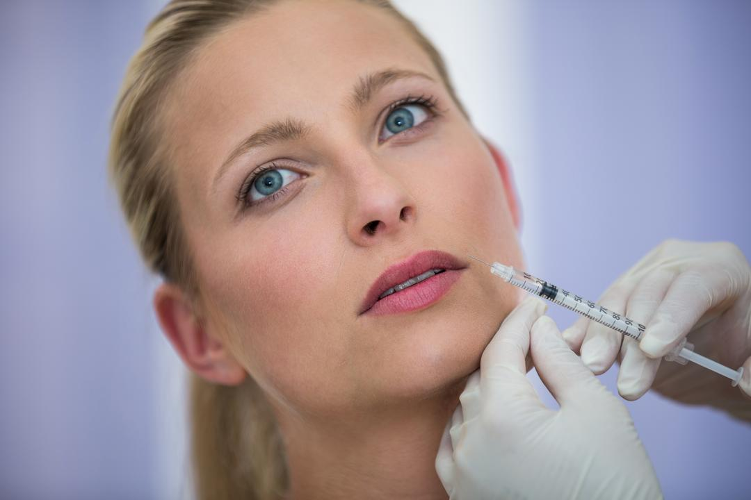 Close-up of female patient receiving a botox injection on face