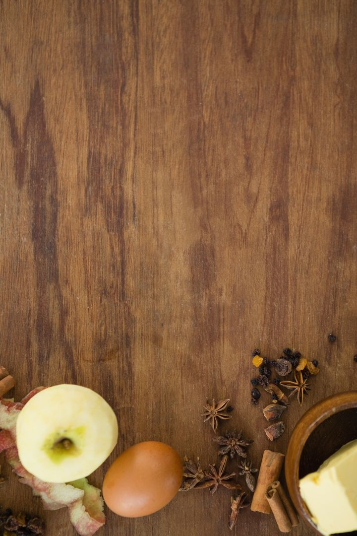 Directly above shot of granny smith apple with egg and spices on wooden table Free Stock Images from PikWizard
