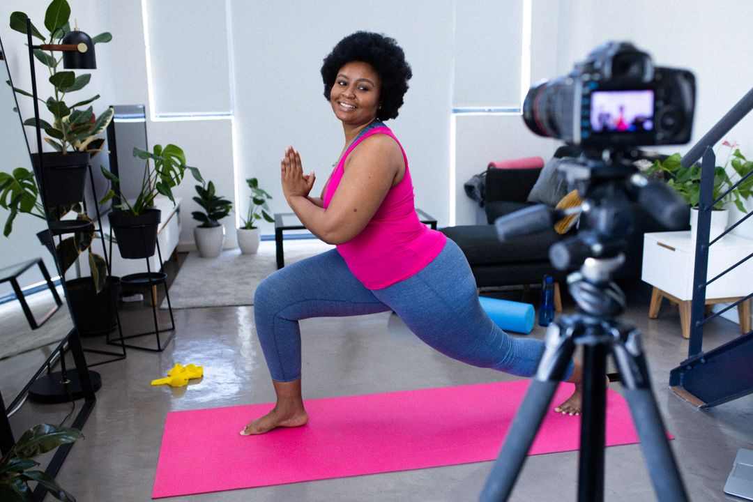 Woman live streaming her fitness routine from home