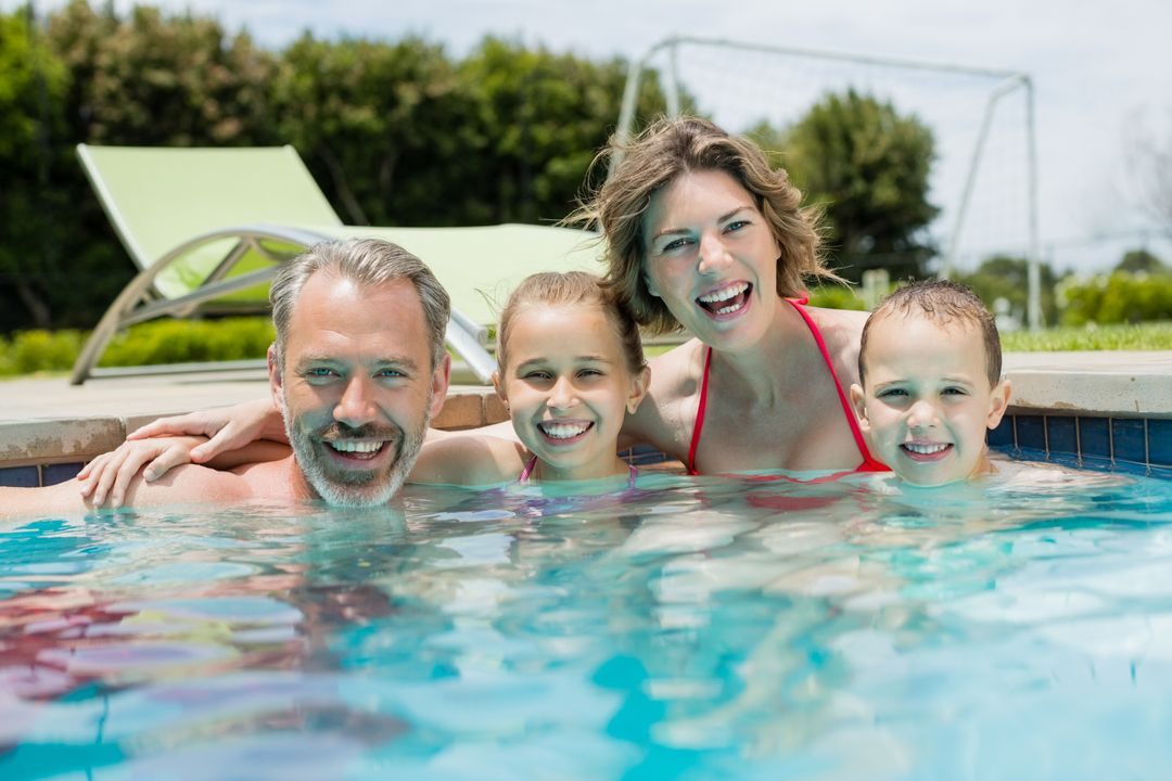 Portrait of smiling family enjoying in swimming pool Free Stock Images from PikWizard