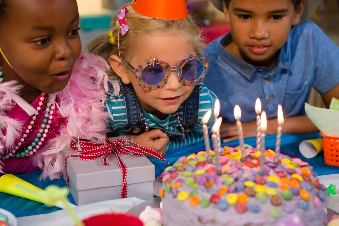 Close up of children looking at birthday cake during party Free Stock Images from PikWizard