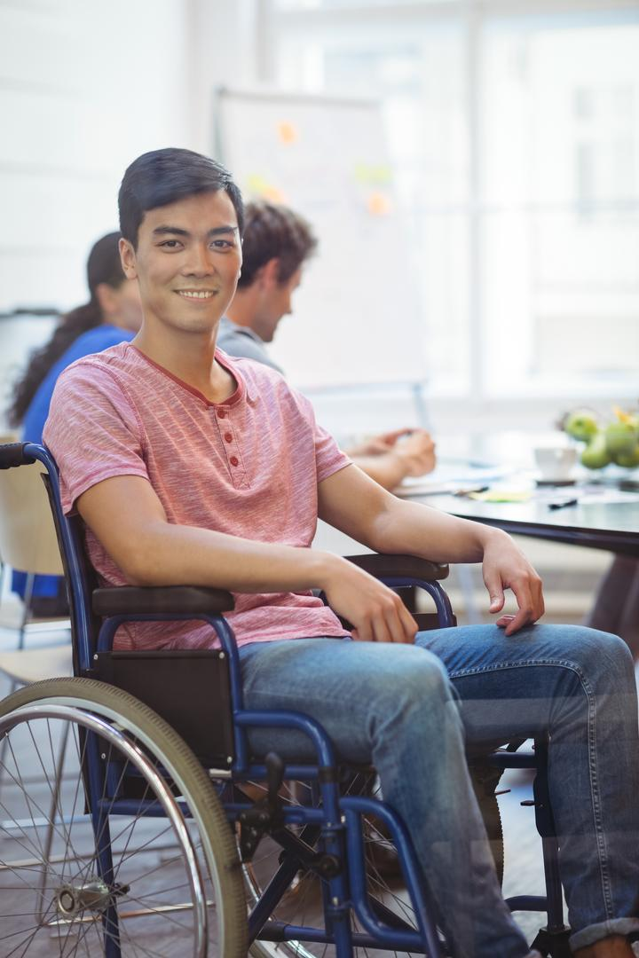 Portrait of handicapped business executive sitting in wheel chair