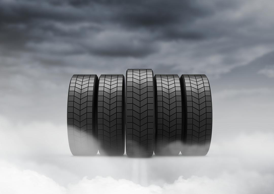 Digital composition of five tyres against cloudy sky
