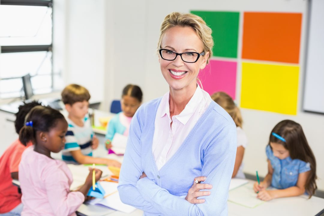 Portrait of teacher standing in classroom with lids in background Free Stock Images from PikWizard
