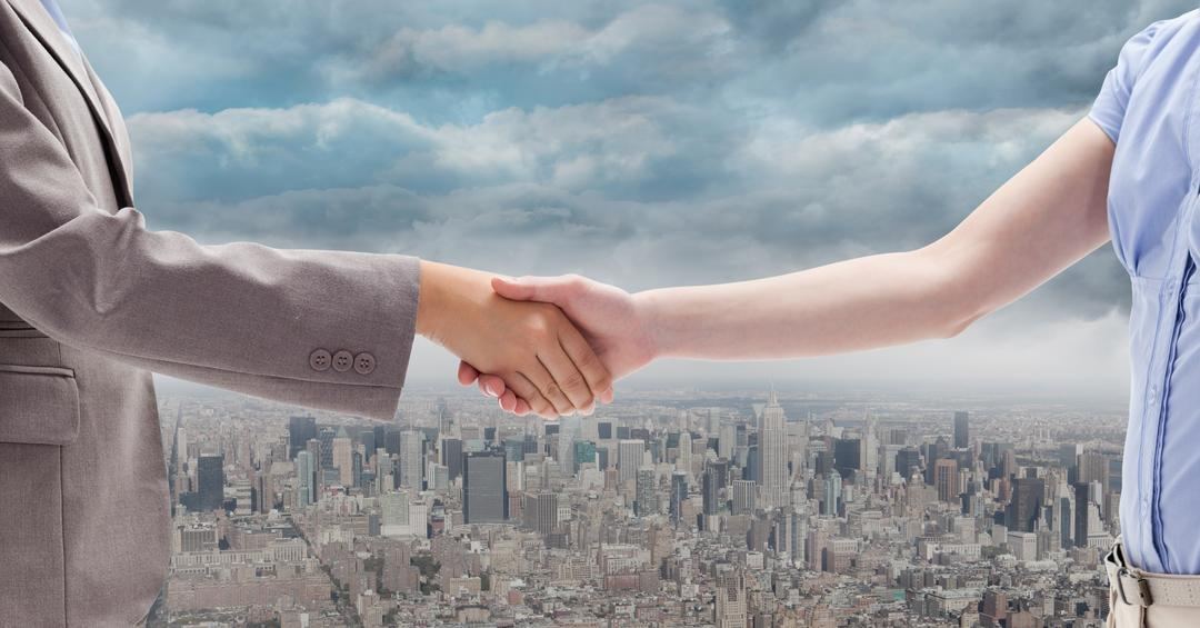 Digital composite of Digitally generated image of  businesswomen doing handshake with city in background Free Stock Images from PikWizard