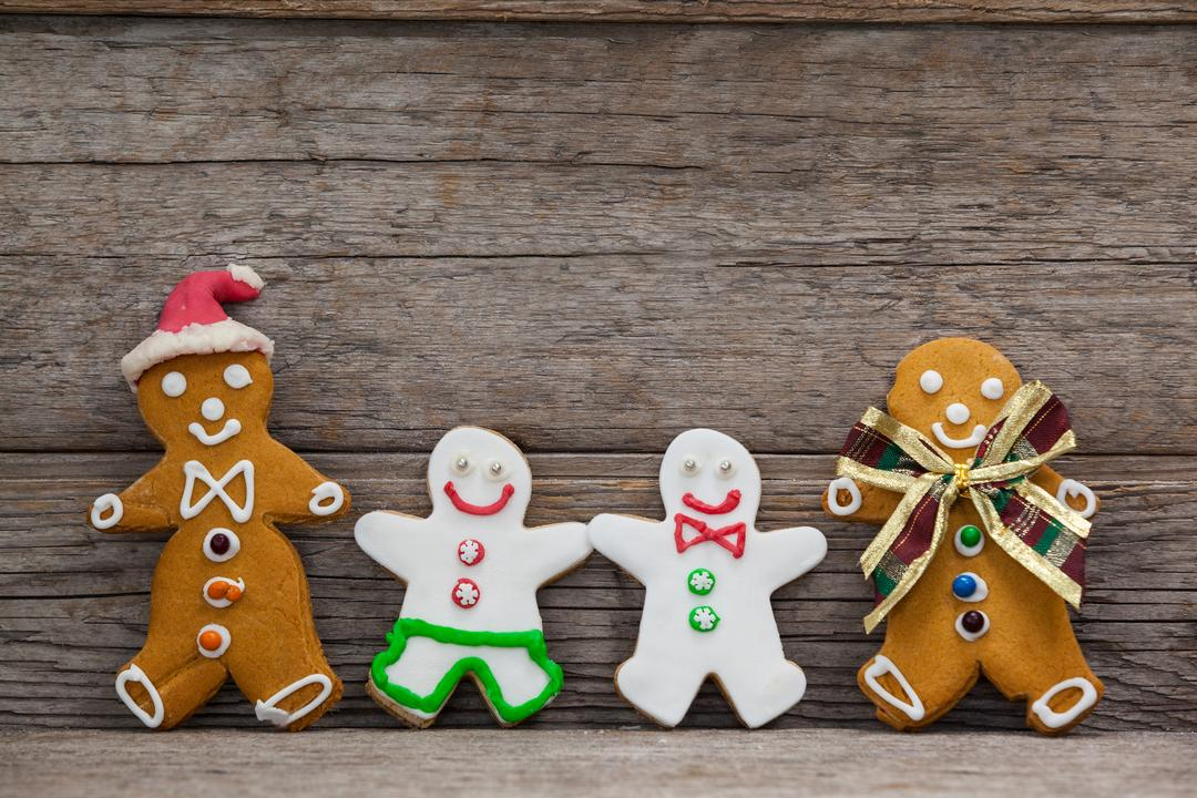 Various types of gingerbread leaning on a plank