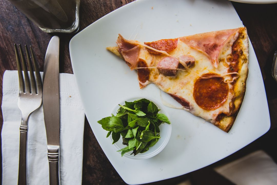Image of a Slice of Pizza on a Plate