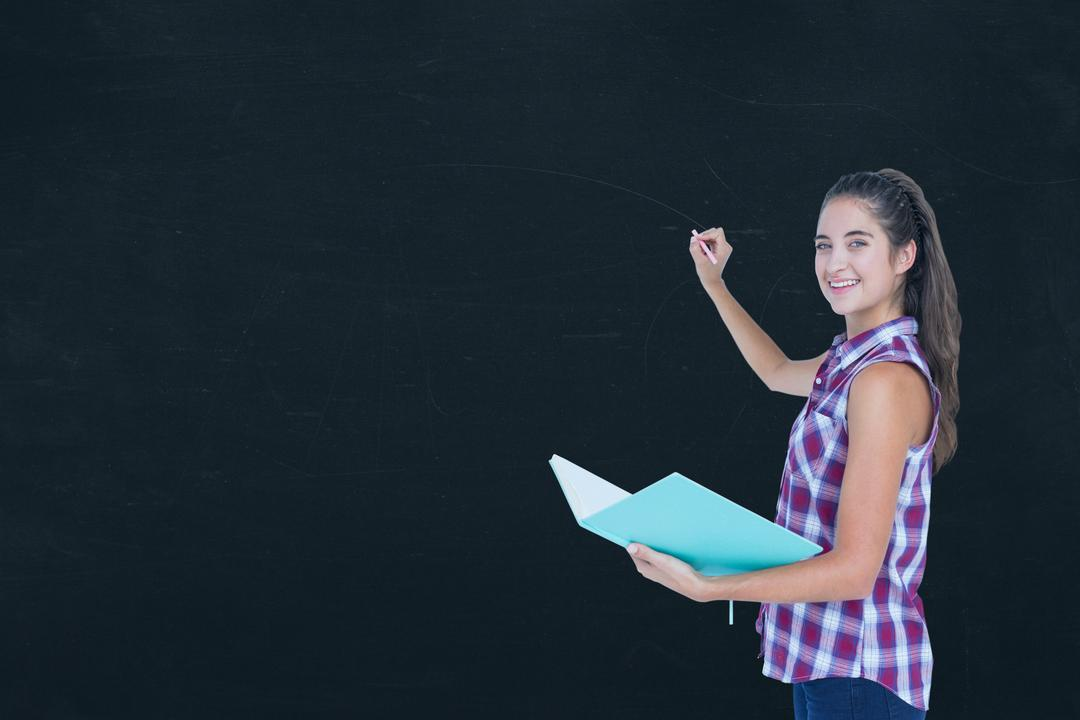 Digital composite of Side view of female student holding book while writing on blackboard