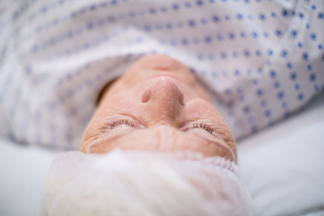Senior woman patient sleeping on bed in hospital room Free Stock Images from PikWizard
