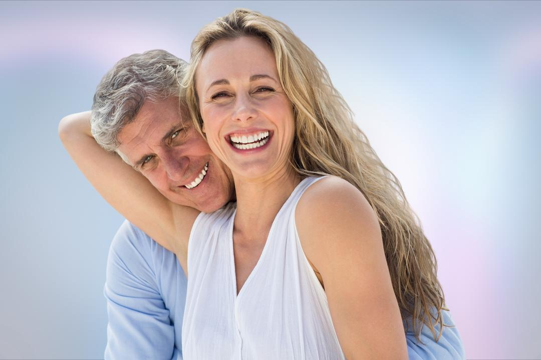 Digital composite of Portrait of smiling senior couple against blue background Free Stock Images from PikWizard