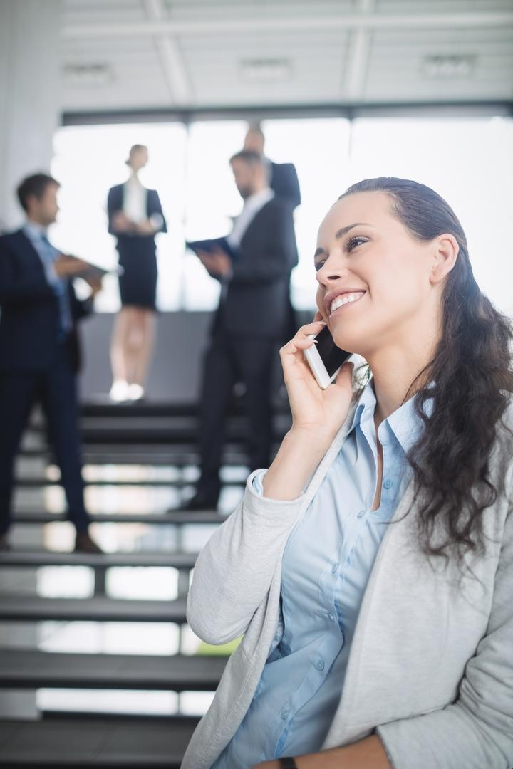 Businesswoman talking on mobile phone in office