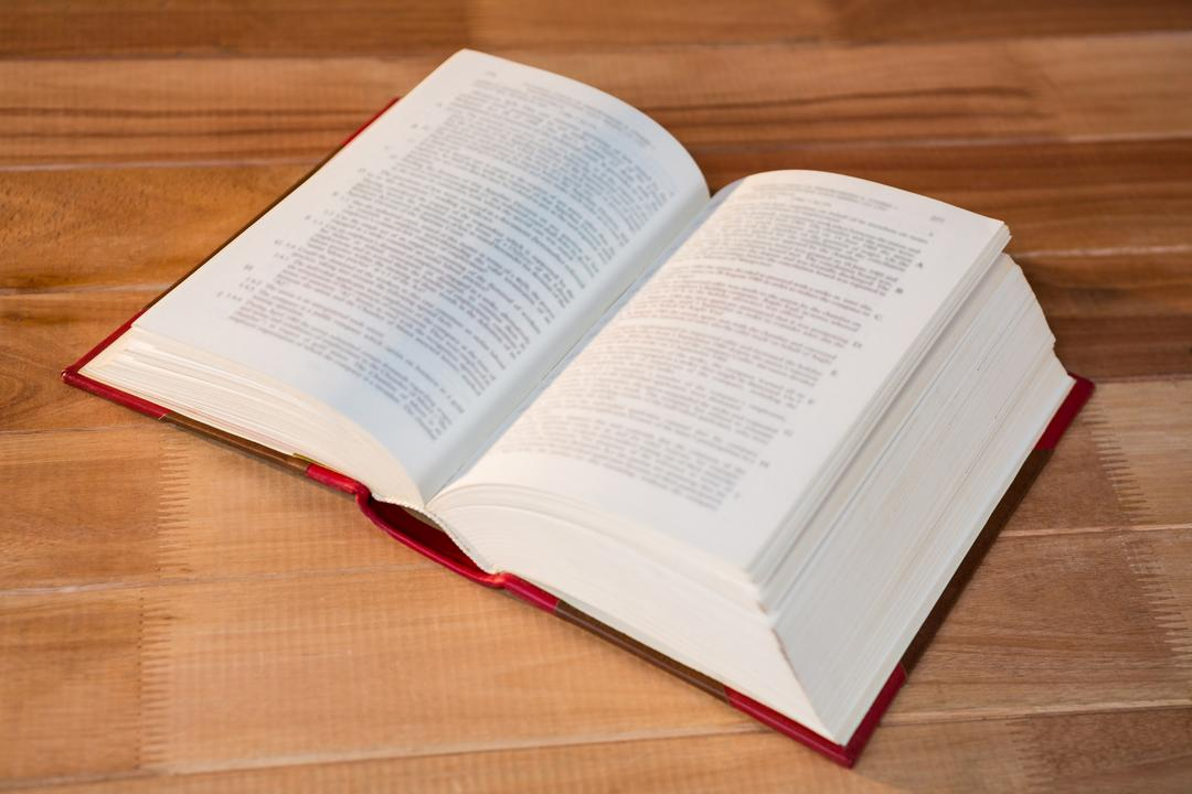 Open book on a wooden table