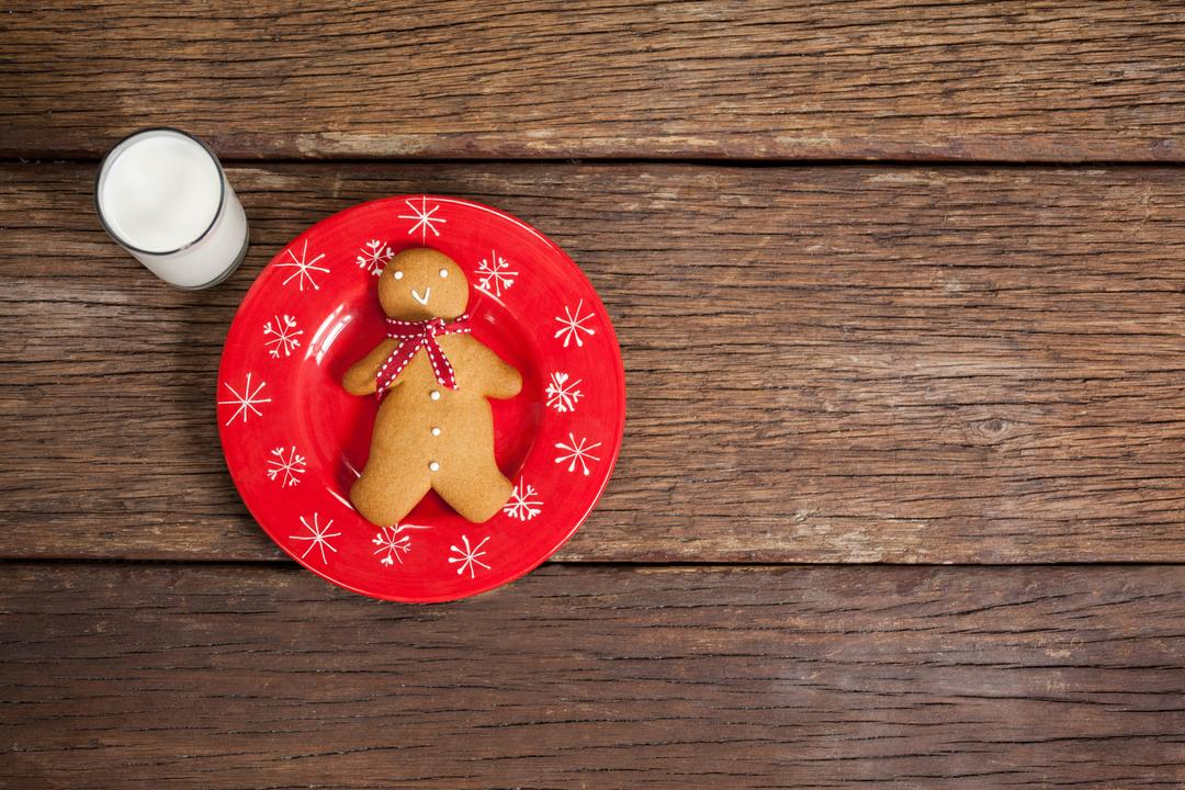 Ginger bread and milk on wooden table during christmas time Free Stock Images from PikWizard