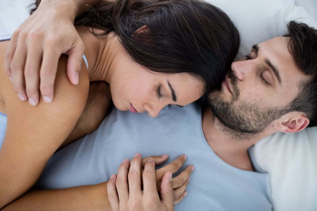 Young romantic couple sleeping on bed in bedroom Free Stock Images from PikWizard