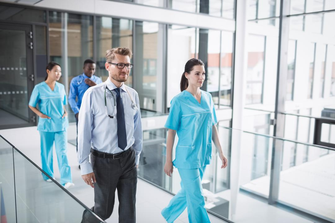 Doctors and nurse walking in corridor at hospital