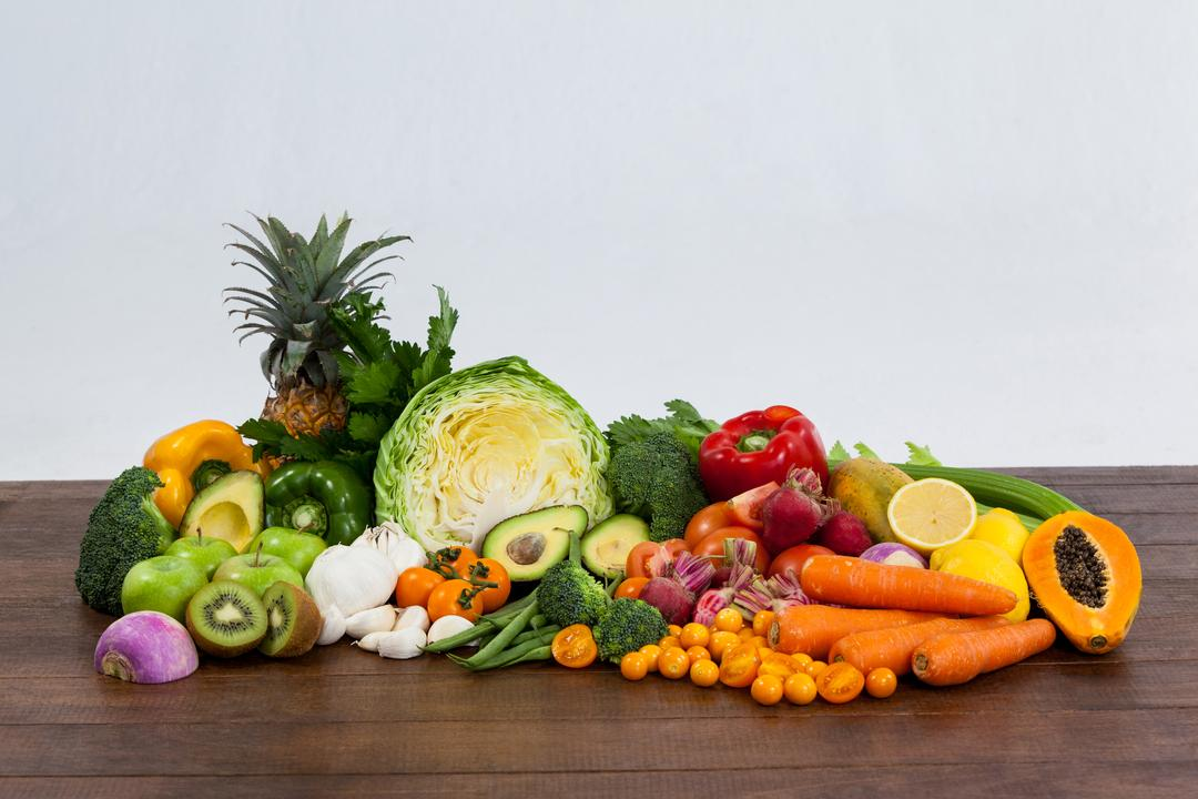 Variety of fresh vegetables and fruit on table - diet concept
