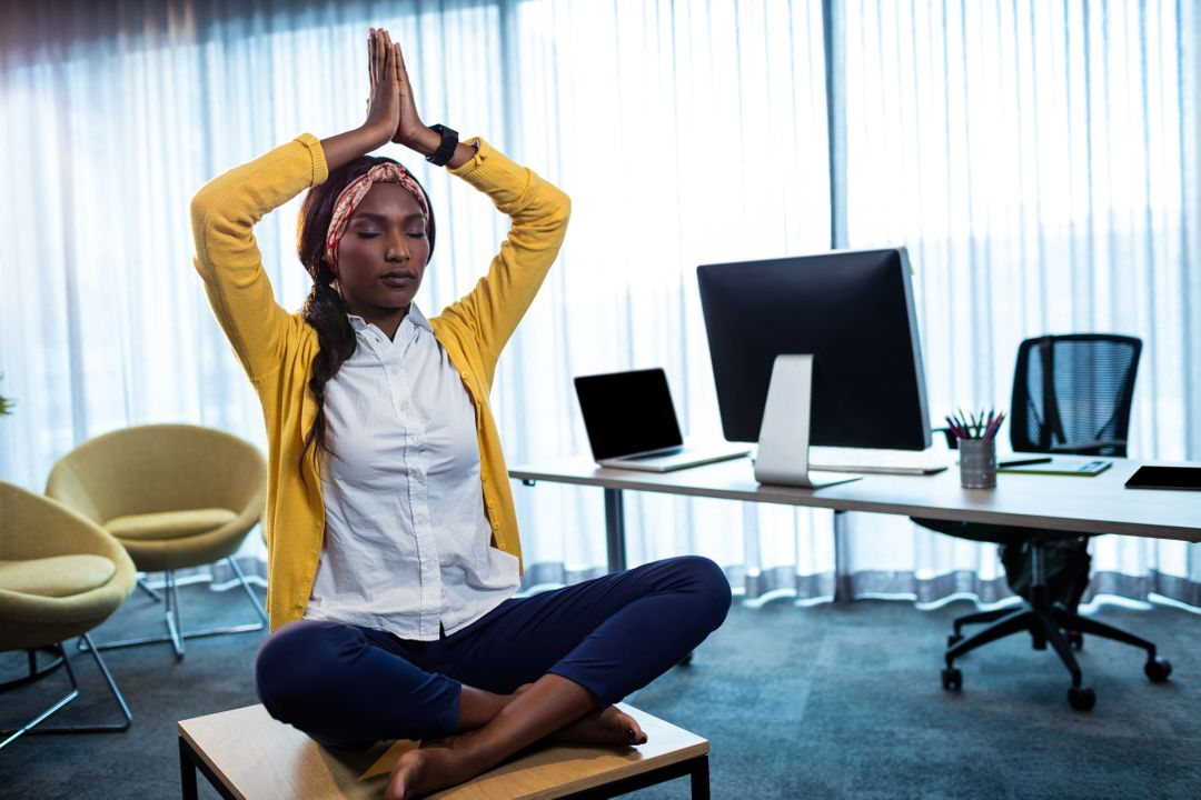 Businesswoman doing yoga at the office Free Stock Images from PikWizard