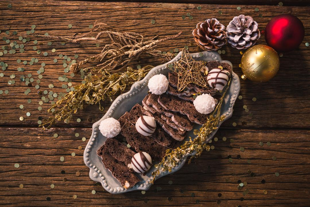Christmas dessert and christmas decoration on wooden table