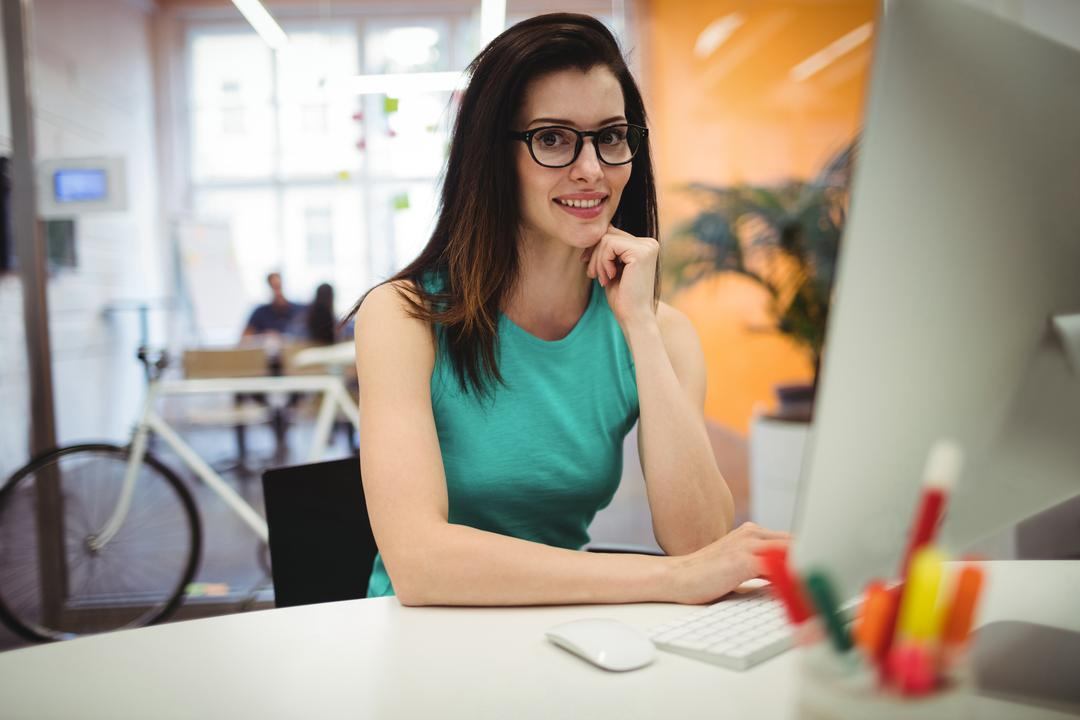 Portrait of beautiful female executive sitting at her desk in office