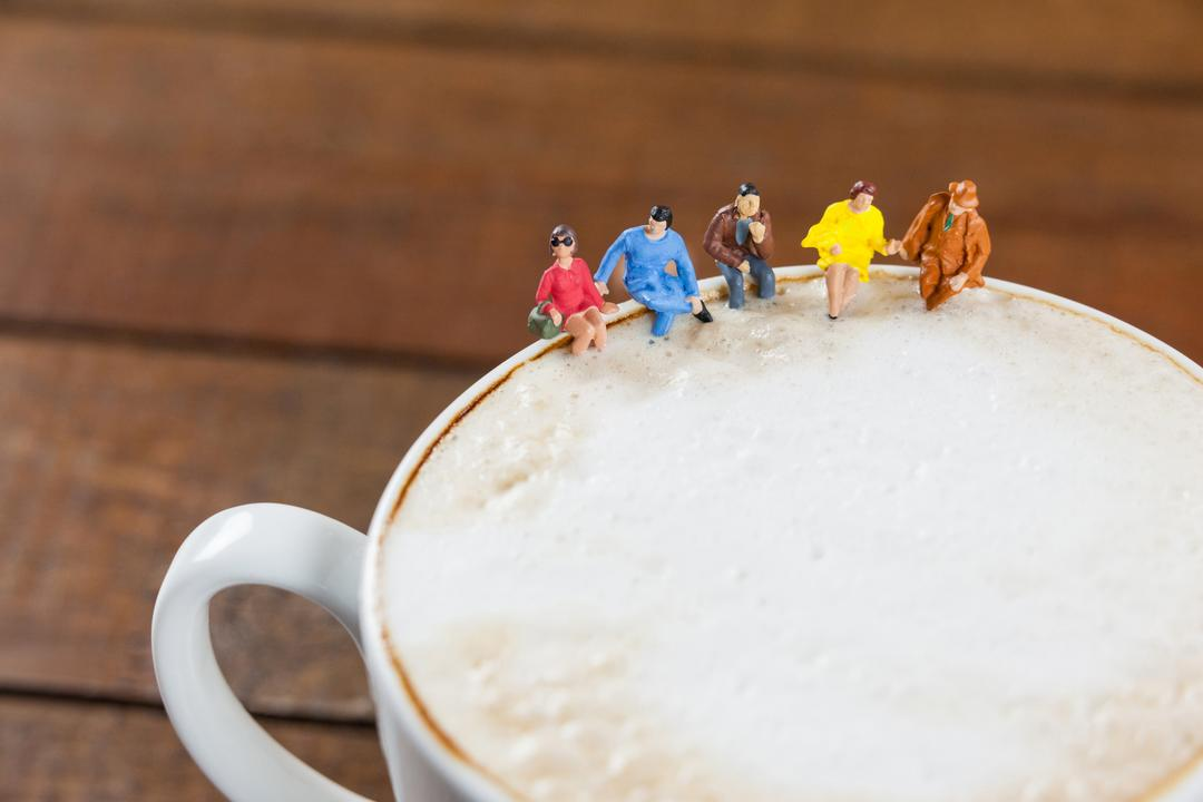 Conceptual image of miniature group of friends having coffee Free Stock Images from PikWizard