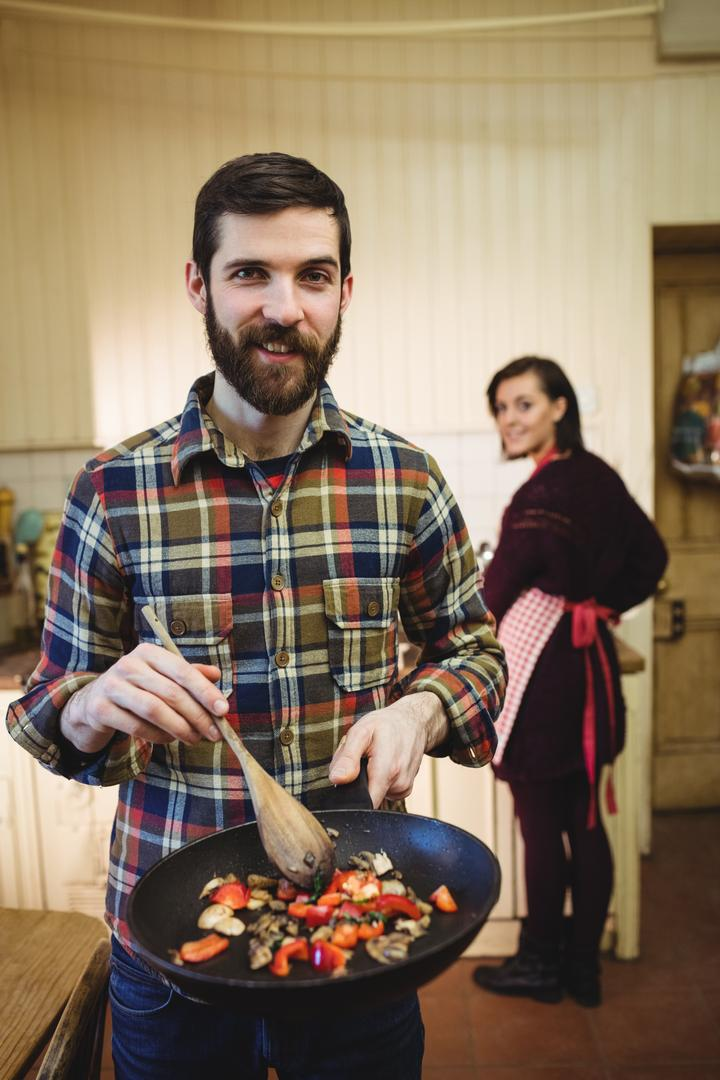 Man preparing food in kitchen at home