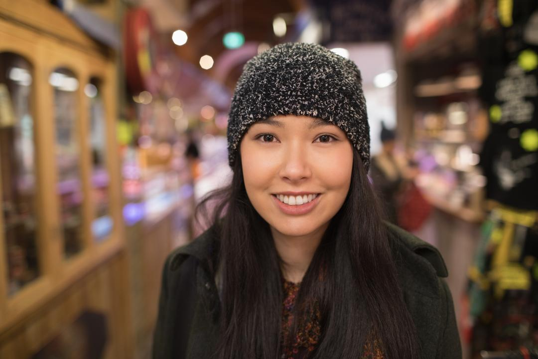 Image of a woman smiling at the camera in a supermarket