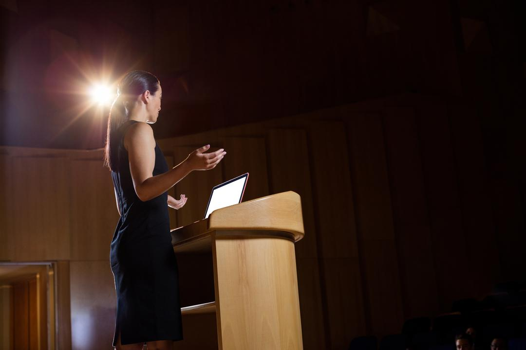 Female business executive giving a speech at conference center Free Stock Images from PikWizard