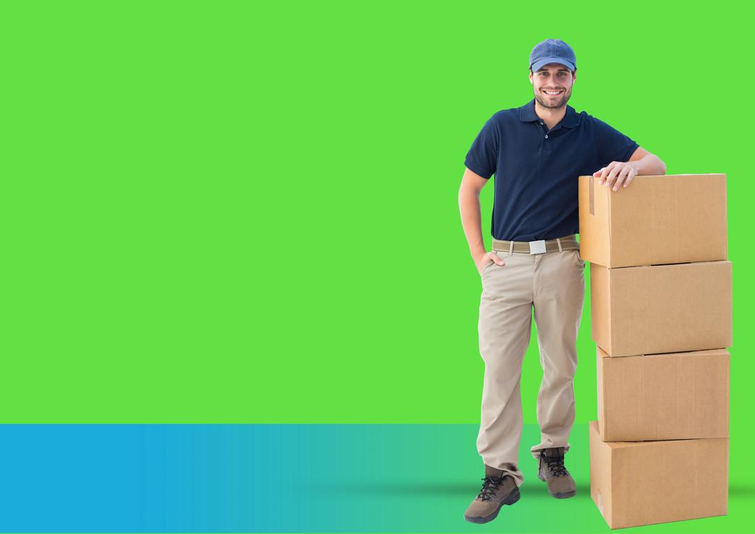 Digital composite image of confident delivery boy standing next to stacked boxes against green background