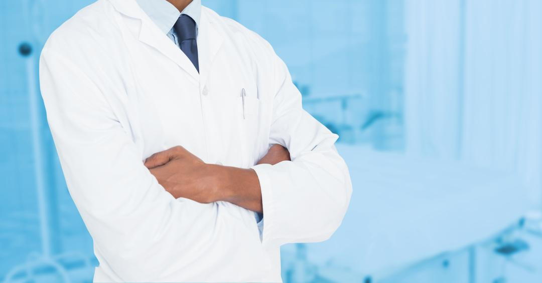 Dentist standing with arms folded