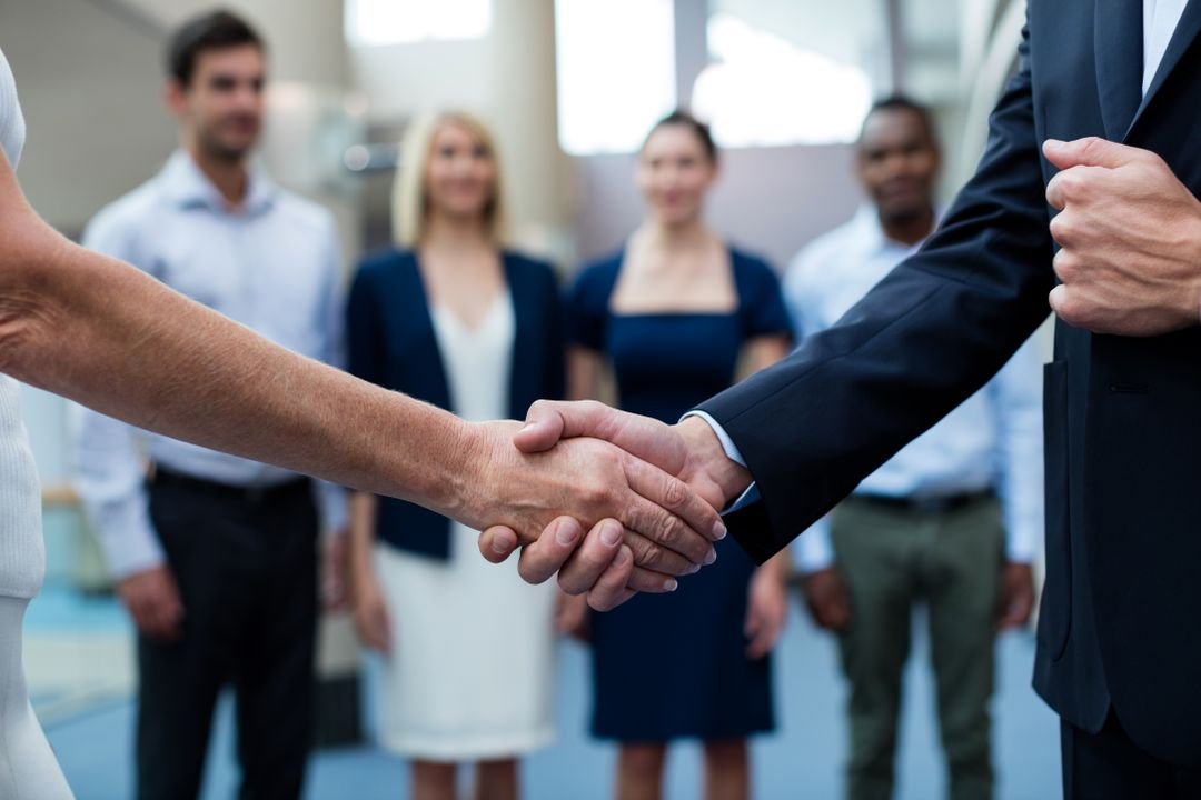 Business executive shaking hands with each other at conference center Free Stock Images from PikWizard