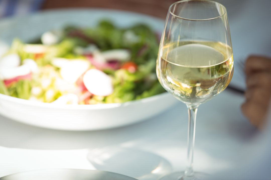 Close-up of food and wine glass on dining table in restaurant Free Stock Images from PikWizard