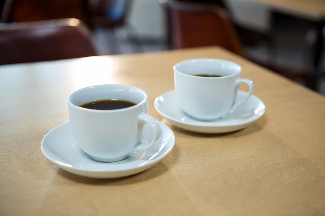 Close-up of black coffee on a table in cafeteria