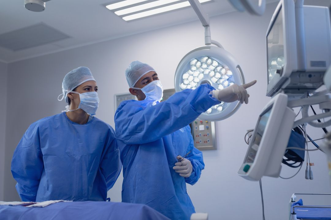 Surgeons performing surgery in operation theater at hospital Free Stock Images from PikWizard