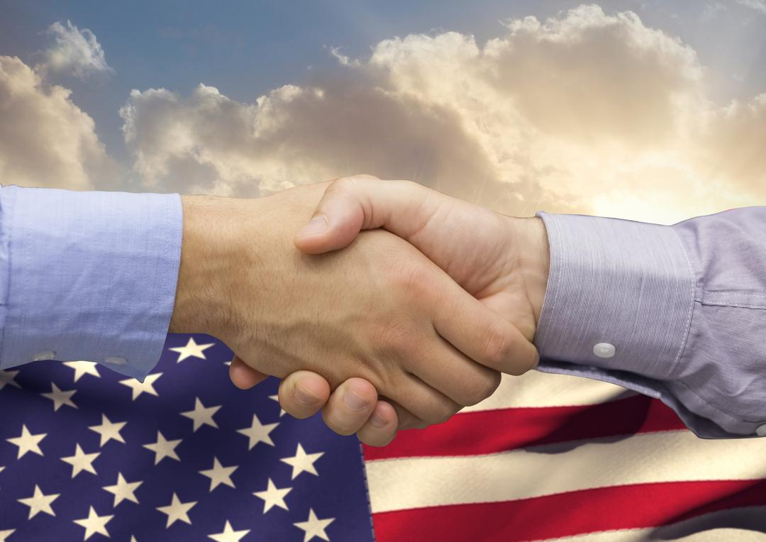 Digital composition of business executives shaking hands against american flag in background Free Stock Images from PikWizard