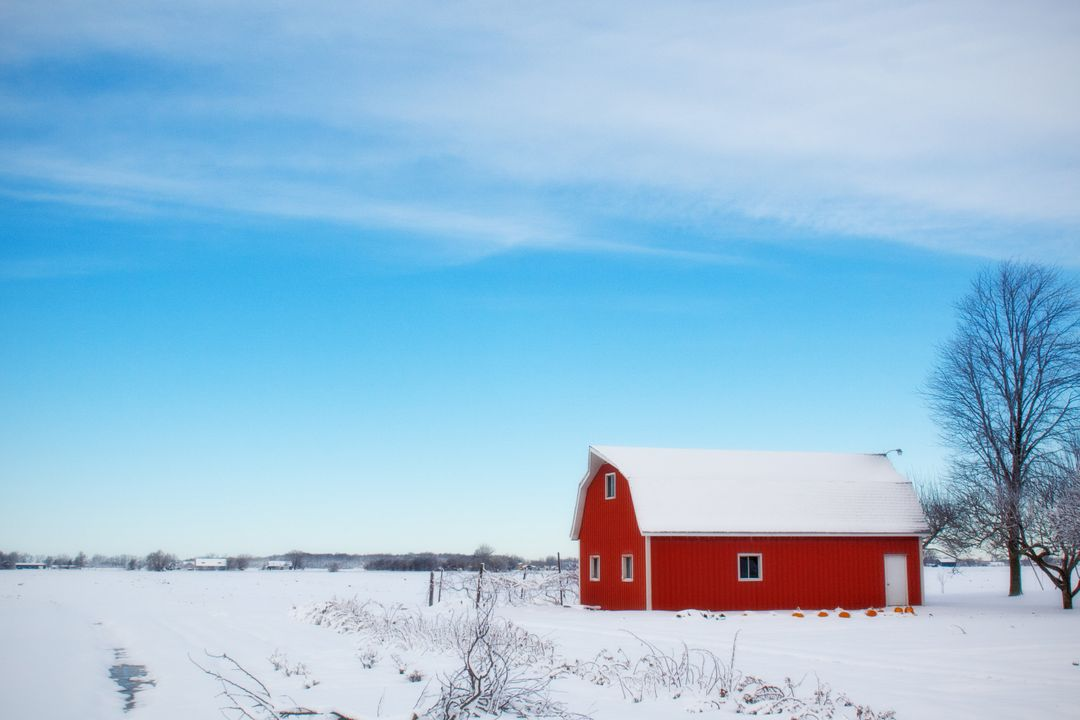 Bright red barn surrounded by white snow