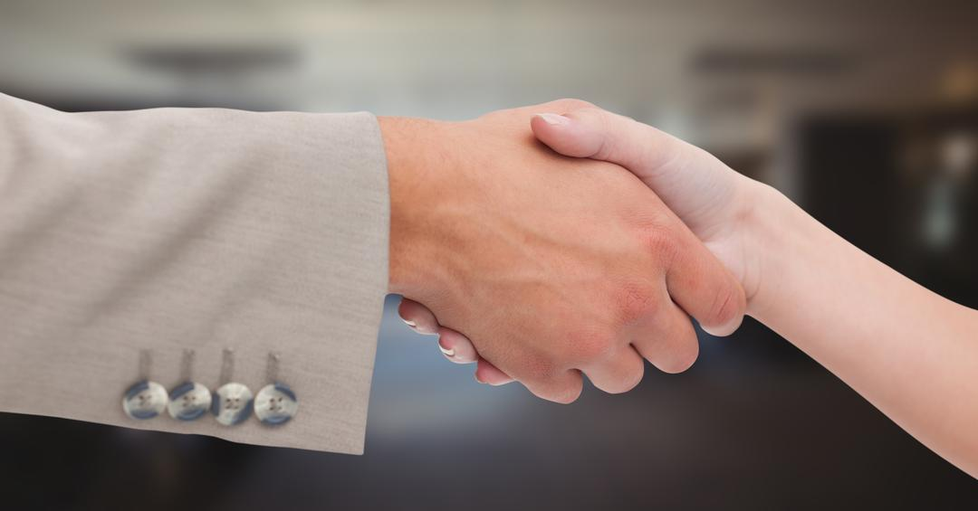 Digital composite of Close-up of handshake in office