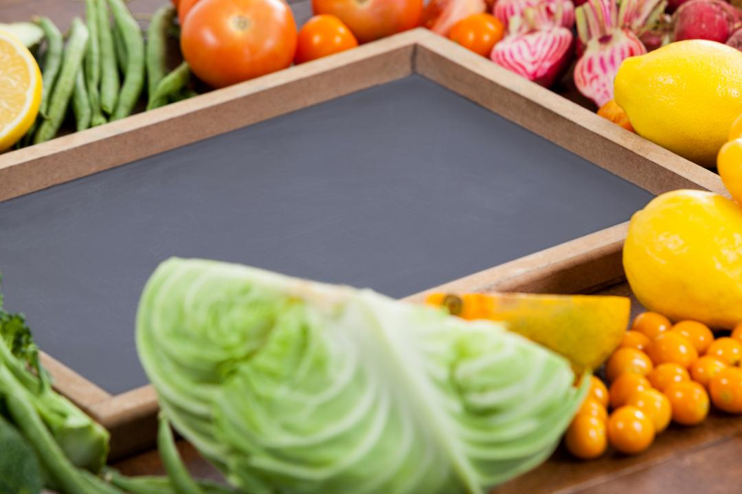 Close-up of wooden tray surrounded with fresh vegetables Free Stock Images from PikWizard