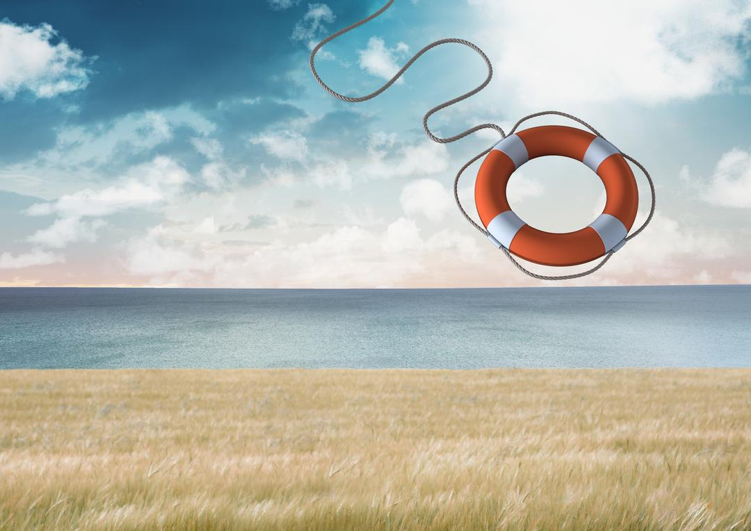 Digital composition of lifebuoy with rope against sky in background Free Stock Images from PikWizard