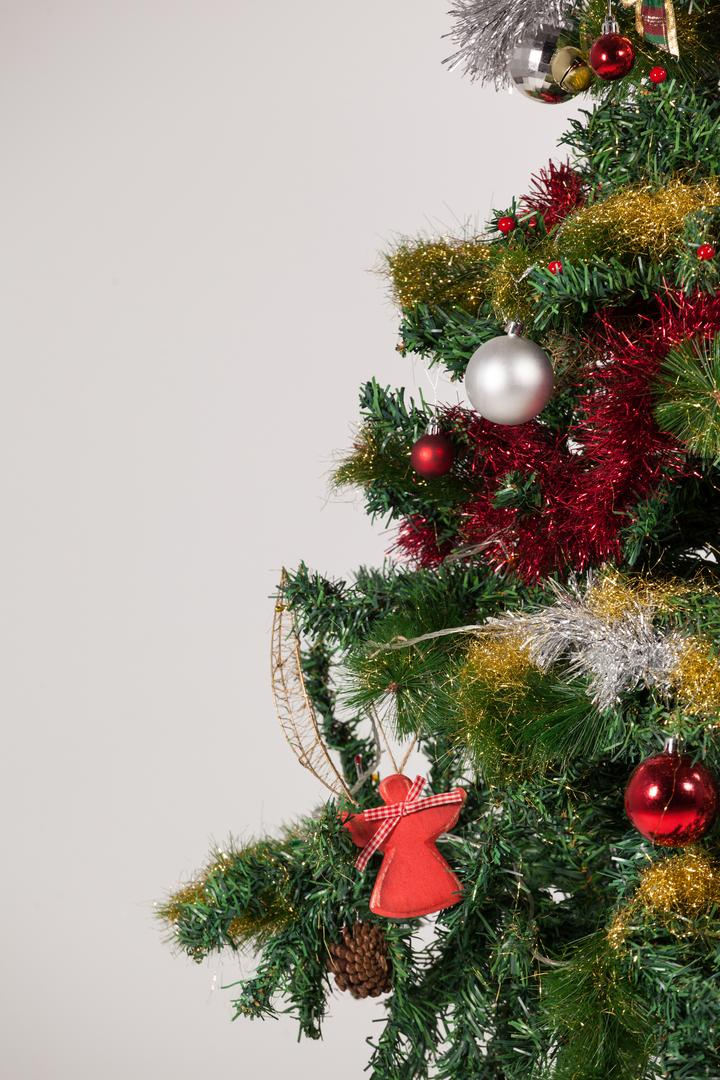 Close-up of christmas tree on white background