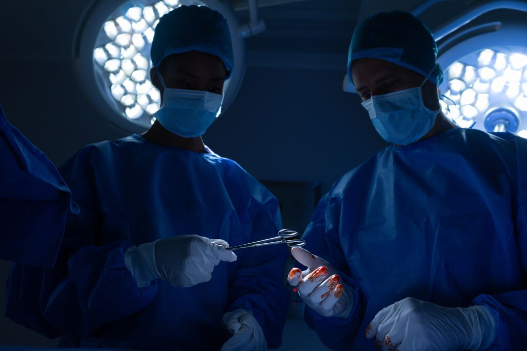 Low angle view of surgeons performing operation in operation theater