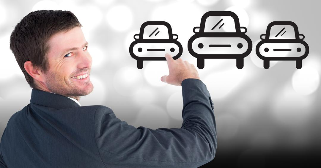 Digital composition of businessman pointing at car icons against bokeh background